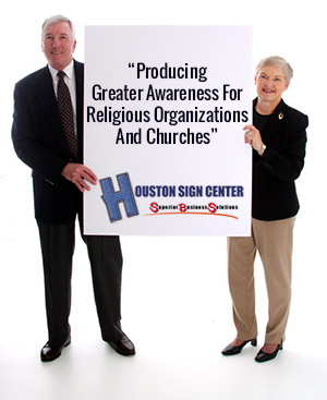 Senior couple holding a church sign